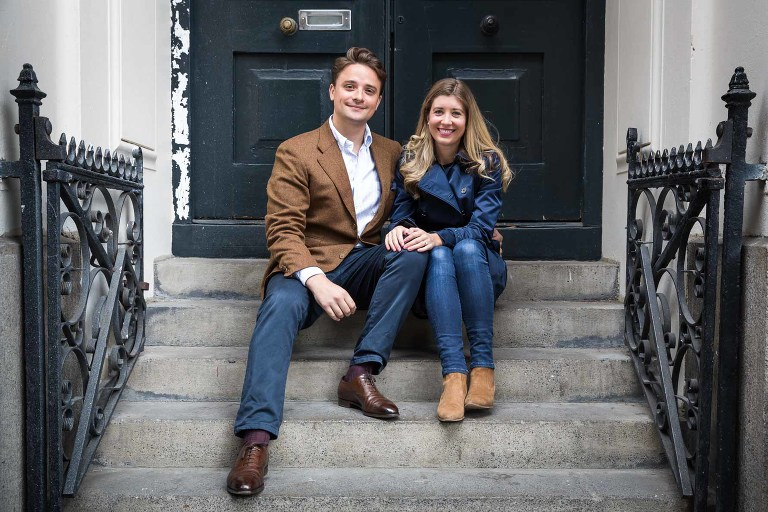Sitting on the steps on an engagement photoshoot