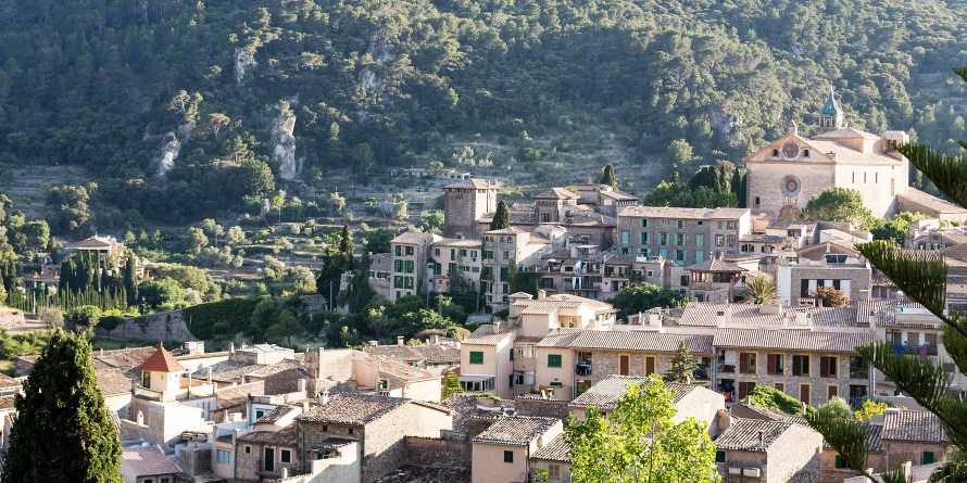 View over Valldemossa with the Valldemossa Hotel on the left and La Cartuja on the right side