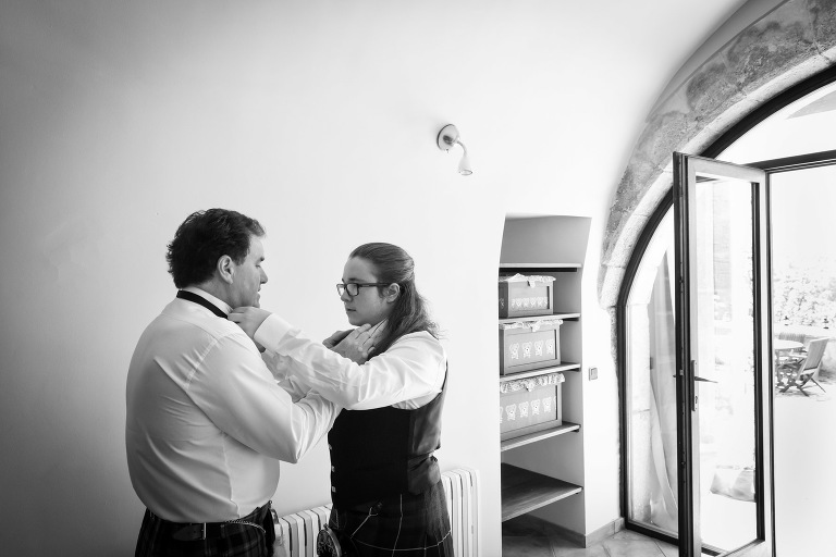Michael and Cameron adjust collars for the Valldemossa Hotel wedding