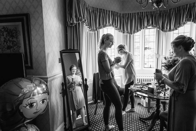 Bridal prep underway before an emotional Hanbury Manor wedding