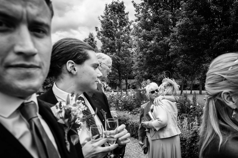 Hugs and tears at a Hanbury Manor wedding in Hertfordshire