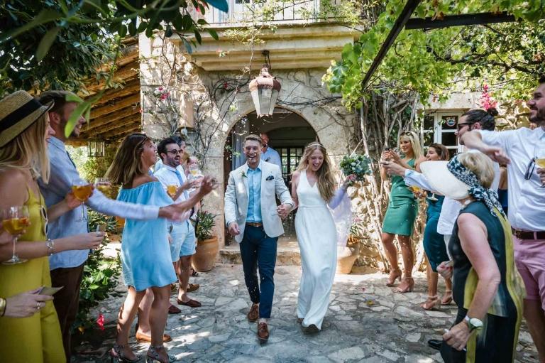 Cathy and Ben on confetti walk during their beautiful Mallorca finca wedding
