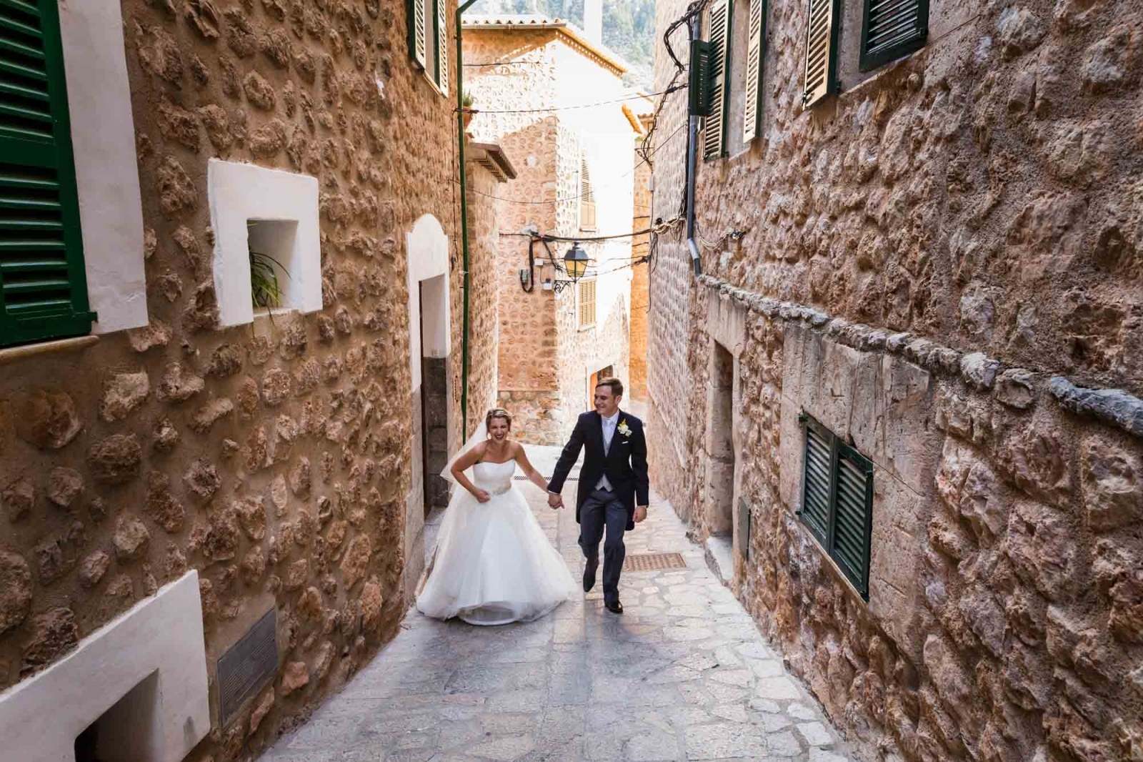 Bride and groom return to Can Vedera by Mallorca wedding photographer Graham Warrellow